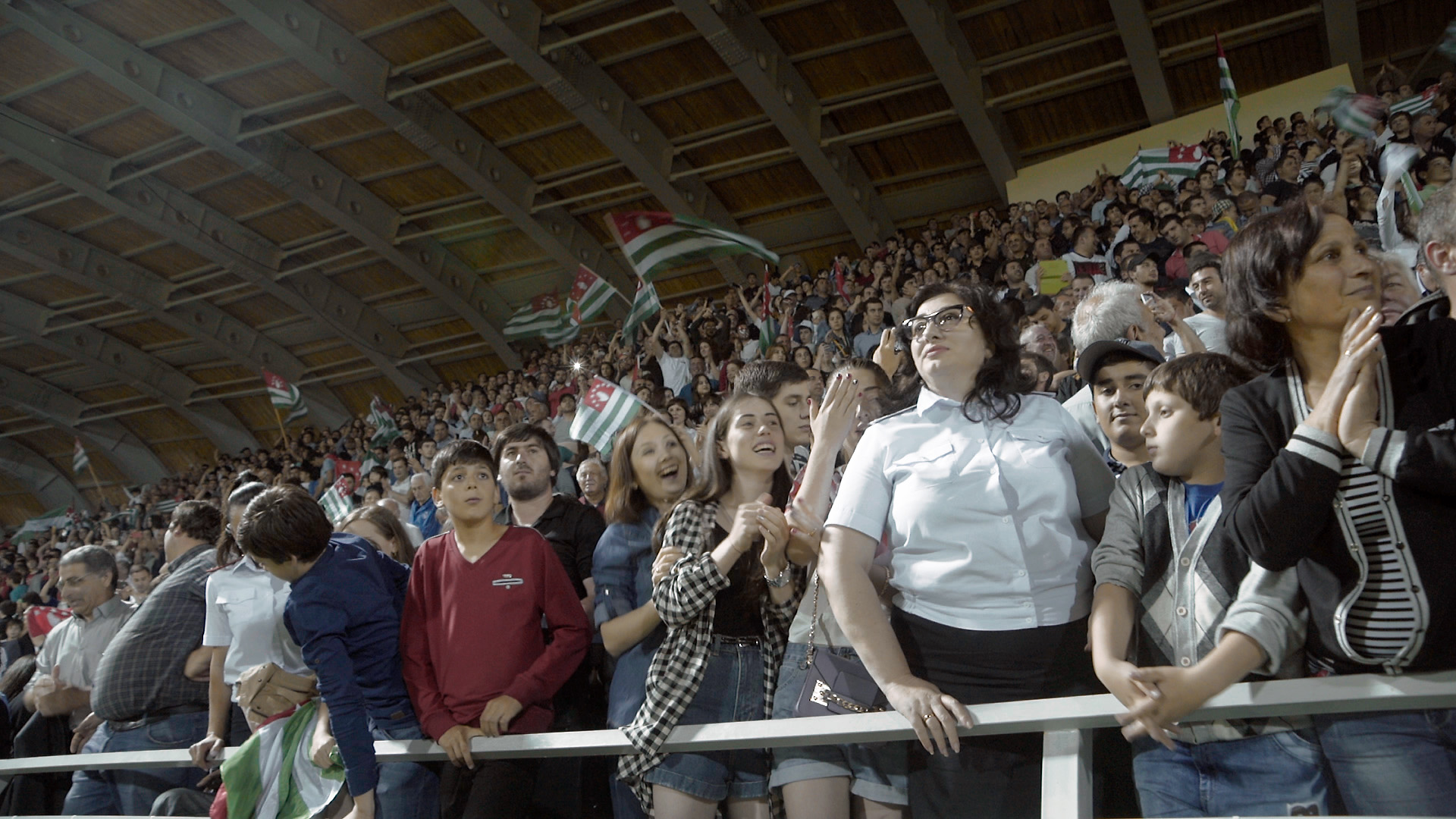 Abkhazian police member witnesses the last moments of the final match during the Abkhazia-Panjab Conifa World Cup Event (june 2016)